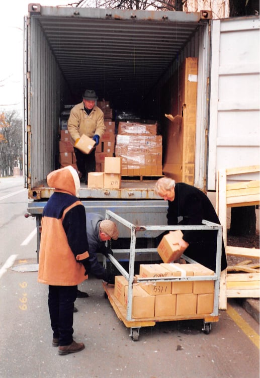 aid for children in Belarus being unloaded from truck by volunteers